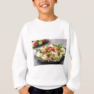 Homemade pasta with stewed chicken and vegetable sweatshirt