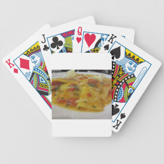 Homemade pasta with tomato sauce, onion, basil bicycle playing cards