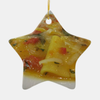 Homemade pasta with tomato sauce, onion, basil ceramic ornament