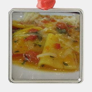 Homemade pasta with tomato sauce, onion, basil metal ornament