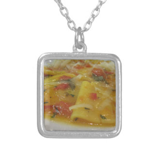 Homemade pasta with tomato sauce, onion, basil silver plated necklace