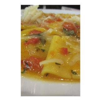 Homemade pasta with tomato sauce, onion, basil stationery