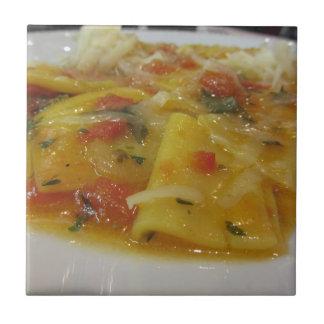 Homemade pasta with tomato sauce, onion, basil tile
