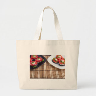 Homemade vegetarian dishes of stewed eggplant large tote bag