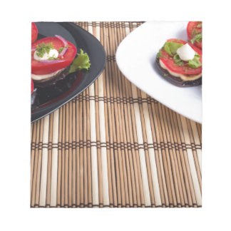 Homemade vegetarian dishes of stewed eggplant notepad
