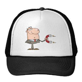 Homme d'affaires utilisant un aimant casquettes