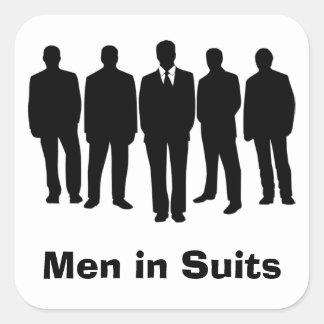 hommes dans des autocollants de costumes