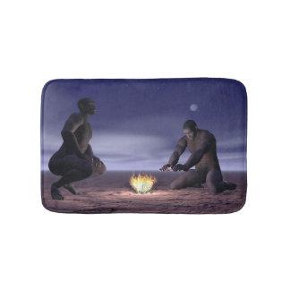Homo erectus and fire - 3D render Bathroom Mat