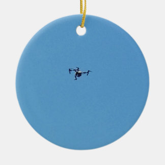 Hoovering Drone Against Blue Sky Simplicity Ceramic Ornament