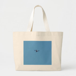 Hoovering Drone Against Blue Sky Simplicity Large Tote Bag