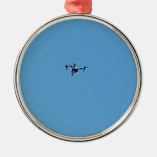 Hoovering Drone Against Blue Sky Simplicity Metal Ornament