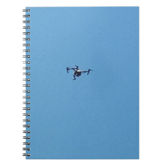 Hoovering Drone Against Blue Sky Simplicity Notebook