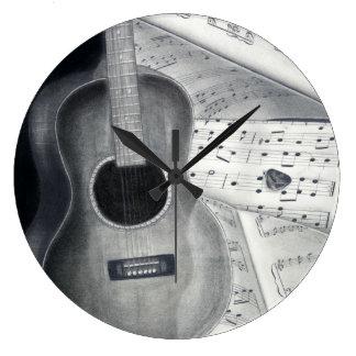 Horloge murale de musique de guitare et de feuille