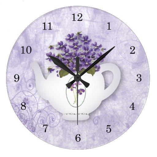 Horloge murale de théière de violettes