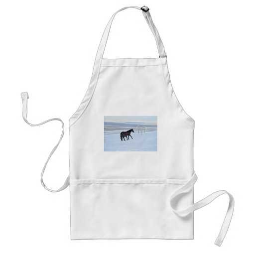 Horse and foal in snow apron