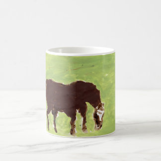 Horse grazing on green background mug