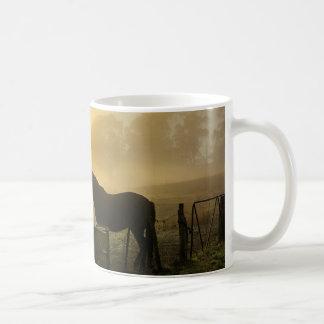 Horse in foggy sunrise coffee mug