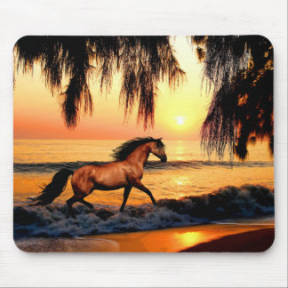 Horse running on sunset beach mouse pad