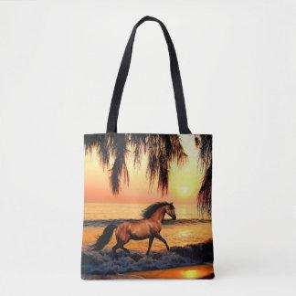 Horse running on sunset beach tote bag