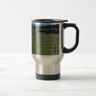 Horses in field with mountains travel mug