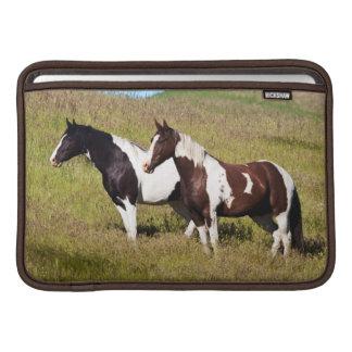 Horses on the hillside MacBook sleeves