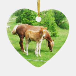 Horses relaxing in the field ceramic heart ornament