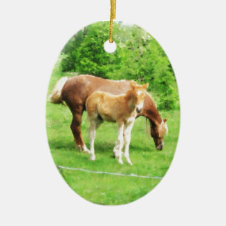 Horses relaxing in the field ceramic oval ornament
