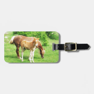 Horses relaxing in the field luggage tag