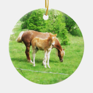 Horses relaxing in the field round ceramic ornament