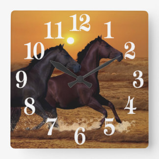 Horses running at ocean sunset square wall clock