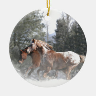 Horses running in the snow ceramic ornament