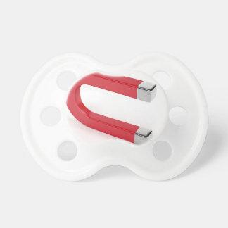 Horseshoe magnet pacifier