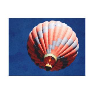 Hot air balloon in a deep blue sky canvas print