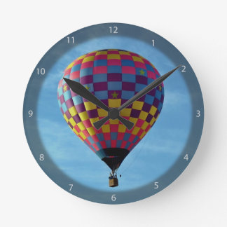 Hot air balloon sails away into the sky round clock