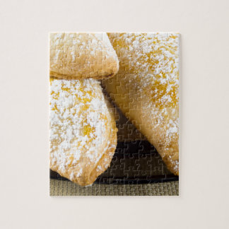 Hot cakes with sweet filling, sprinkled jigsaw puzzle