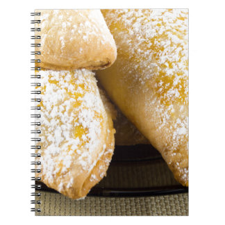 Hot cakes with sweet filling, sprinkled notebooks