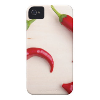Hot chili peppers on a light wooden board iPhone 4 Case-Mate case