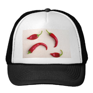 Hot chili peppers on a light wooden board trucker hat