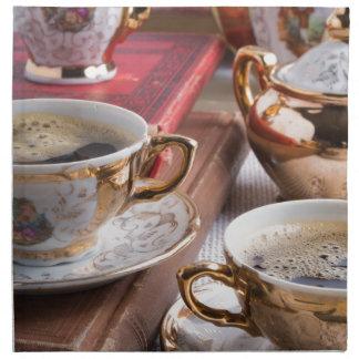 Hot coffee and retro crockery for breakfast napkin