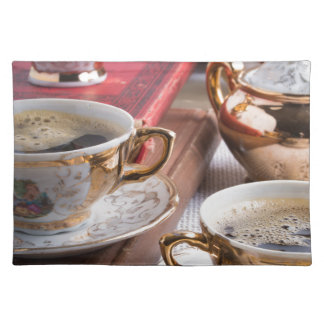 Hot coffee and retro crockery for breakfast placemat