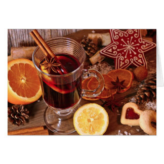 Hot mulled wine appetizingly with spices decorates card