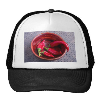 Hot red chili peppers on a fabric background trucker hat