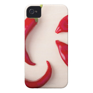 Hot red chili peppers on a light wooden board iPhone 4 cover