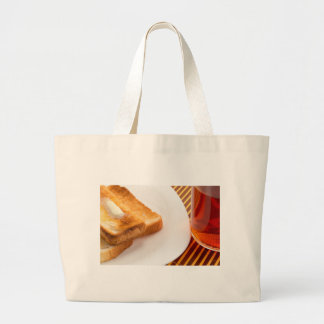 Hot toast with butter and cup of tea large tote bag