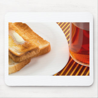 Hot toast with butter and cup of tea mouse pad