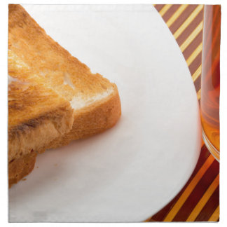 Hot toast with butter and cup of tea napkin