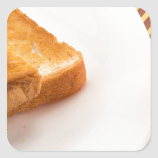 Hot toast with butter and cup of tea square sticker