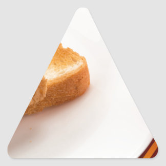 Hot toast with butter and cup of tea triangle sticker