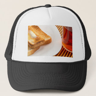 Hot toast with butter and cup of tea trucker hat