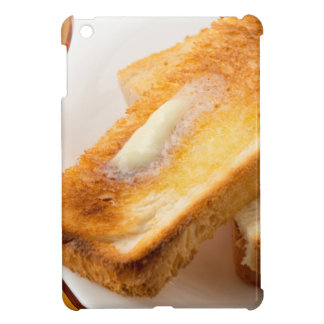 Hot toast with butter on a white plate close-up iPad mini cases